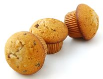Muffins with chocolate filling. Isolated on white background Stock Photography