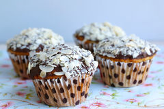 Muffins with chocolate and flaked almonds Stock Photos