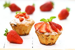 Muffins. Chocolate and strawberry muffins Shallow DOF royalty free stock photography