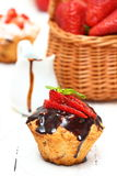 Muffins. Chocolate and strawberry muffins Shallow DOF stock photos