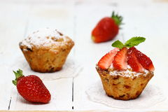 Muffins. Chocolate and strawberry muffins stock photography