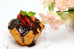 Muffins. Chocolate and strawberry muffins Shallow DOF stock image