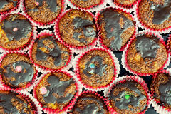 Muffins with chocolate on a tray Stock Photos