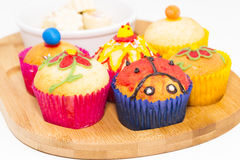 Muffins and chocolates. Royalty Free Stock Photography