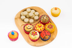 Muffins and chocolates. Royalty Free Stock Photo