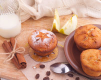 Muffins with cinnamon and icing sugar Stock Photos