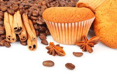 Muffins and coffee beans Stock Photos