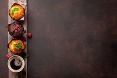 Muffins and coffee. Muffins with berries and coffee. Top view with space for your text Stock Images