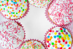 Muffins. Colored sweet muffins in the white plate Royalty Free Stock Image