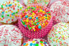 Muffins. Colored sweet muffins in the white plate Stock Photo