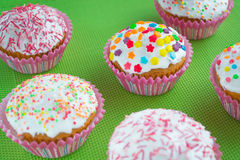 Muffins. Colored sweet muffins in the white plate Royalty Free Stock Images