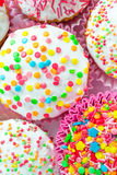 Muffins. Colored sweet muffins in the white plate Stock Images