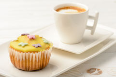 Muffins covered with icing sugar on white plate and cup of coffee. Stock Photo