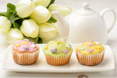 Muffins covered with icing sugar on white plate. Royalty Free Stock Photography