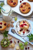 Muffins with cranberries, fruit and milk for Breakfast Royalty Free Stock Photos