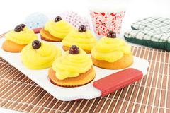 Muffins with cream Royalty Free Stock Image