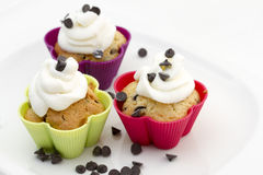 Muffins with cream and chocolate pieces Stock Image