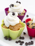 Muffins with cream and chocolate pieces Stock Photo