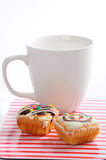 Muffins with cup of coffee Stock Photos