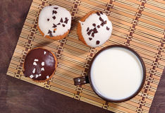 Muffins and cup of milk Stock Images
