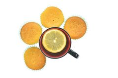 Muffins and a cup of tea with lemon Stock Photography