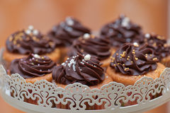 Muffins with dark chocolate cream Stock Images