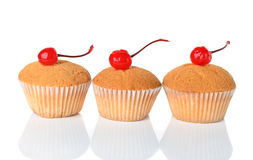 Muffins decorated with cherry Royalty Free Stock Image