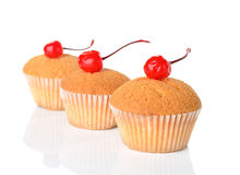 Muffins decorated with cherry Royalty Free Stock Photo