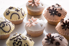 Muffins with decorated top. S in paper cups stock photos