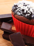 Muffins with desiccated coconut and pieces of chocolate Stock Photos