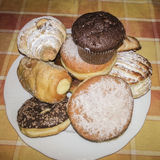Muffins & donuts & croissant. Plate with muffins, donuts, croissant Stock Images