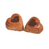 Muffins in een hartvorm op een wit Stock Foto