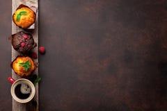 Muffins en koffie Stock Afbeeldingen