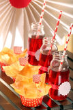 Muffins with filo pastry and cranberry juice in bottles Stock Photography