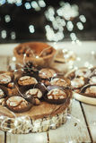 Muffins in forms and nuts Royalty Free Stock Image