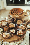 Muffins in forms and nuts Stock Images