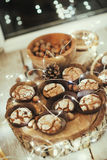 Muffins in forms and nuts Stock Photos