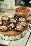 Muffins in forms and nuts Royalty Free Stock Photo