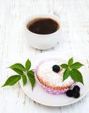 Muffins with fresh blackberries Stock Photo