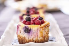 Muffins with fresh blueberry, blackberry, cranberry and strawberry royalty free stock photography