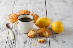 Muffins and fresh lemons on wooden table Royalty Free Stock Photos