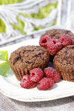 Muffins with fresh raspberries on wooden tray Stock Images
