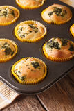 Muffins with fresh spinach and feta cheese close up in baking di Stock Images