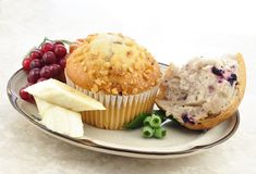 Muffins and fruits Stock Photography