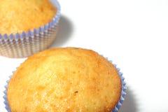Muffins getrennt worden auf Weiß Lizenzfreie Stockfotografie