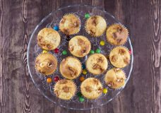 Muffins on a glass plate on a wooden background top Royalty Free Stock Image