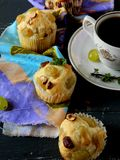 Muffins with grapes Stock Photos