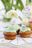 Muffins with green icing and colorful sprinkles Stock Image