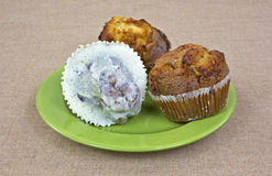 Muffins on green plate Stock Image