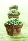 Muffins with green topping Stock Images